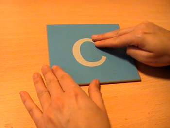 sandpaper letters - drawing a letter with your finger